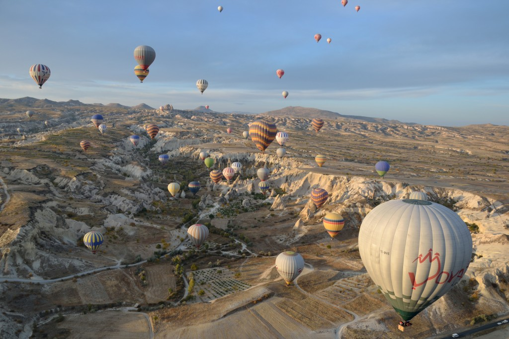 a group of balloons in the capadocia sky