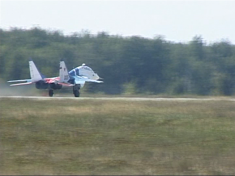 taking off down the runway in a MIG-29 about to fly to the edge of space
