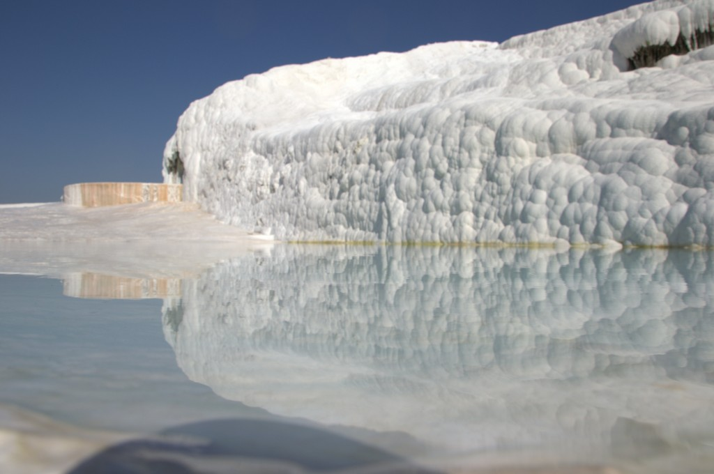 reflection in the salt water of a pamukkale pool
