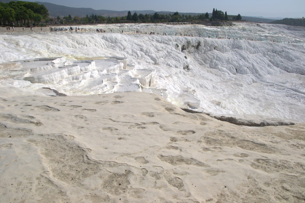 Some of the dry pools at Pamukkale looking towards the tourist path