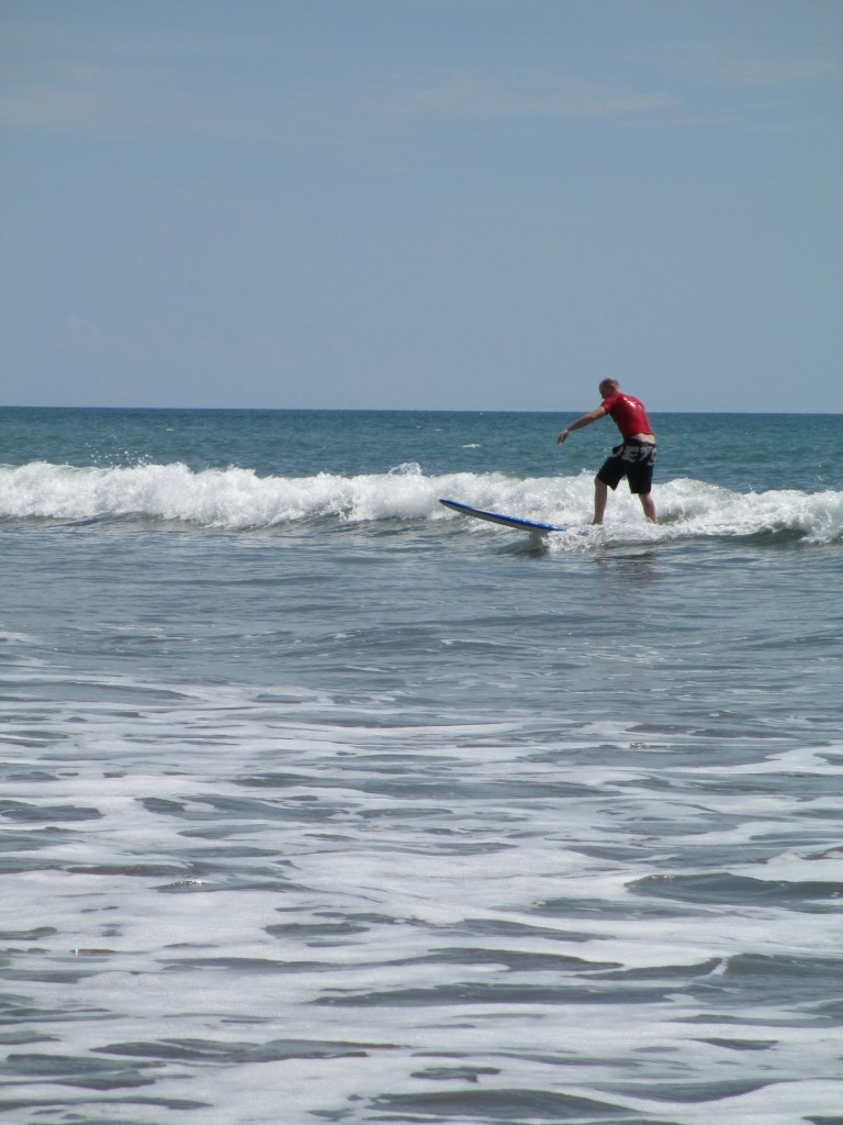 catching a wave at Panama Surf School